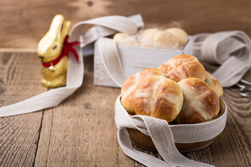 Homemade Easter hot cross buns in wooden bowl