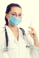 Doctor in protective mask with syringe