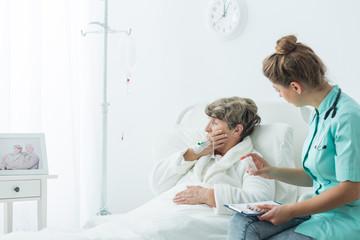 Nurse giving medicines