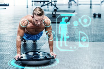 Composite image of muscular man doing bosu ball exercises
