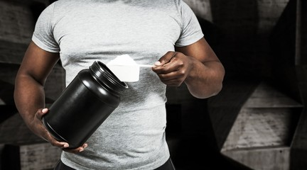 Composite image of fit man scooping protein powder