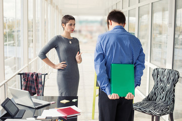 Angry female boss talking to worker male in office..Business woman. Critical situation, problem, management