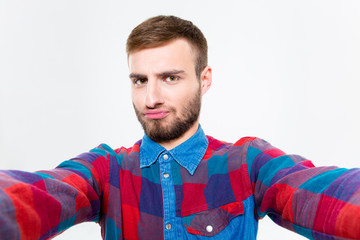 Selfie photo of attractive confident young man in plaid shirt