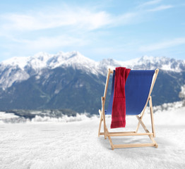blue chairs and mountains