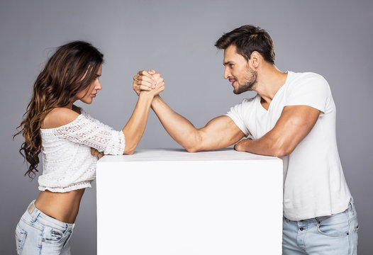 Beautiful couple doing arm wrestling challenge