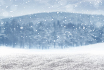 Winter background, falling snow over snowy landscape with copy