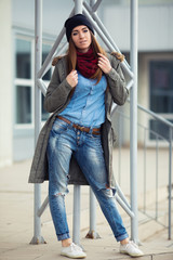 young woman in urban wear style with different emotions on parki