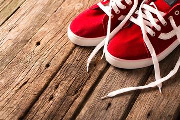 Vintage hanging shoes on wooden background