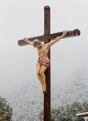 Christian cross with a crucifix in the church on a background of