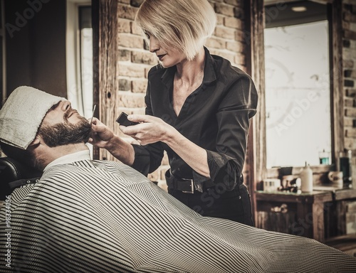 client during beard and moustache grooming in barber shop stockfotos und lizenzfreie bilder. Black Bedroom Furniture Sets. Home Design Ideas