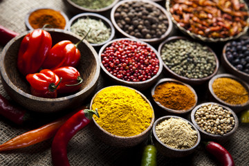 Wall Mural - Assortment of spices in wooden bowl background