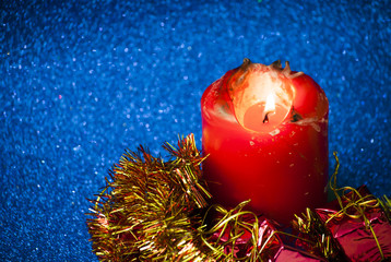 Christmas gifts with a lighted candle