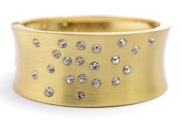 gold bracelet with diamonds on a white background