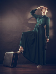 Woman retro style with old suitcase and fan