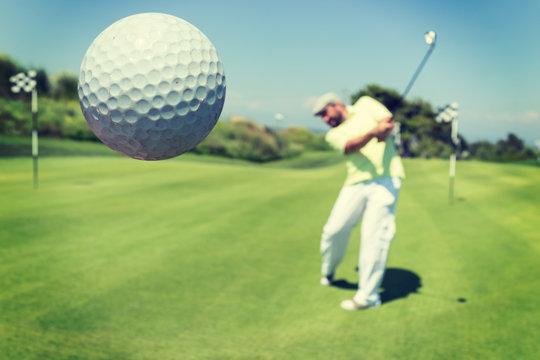Man playing golf at club
