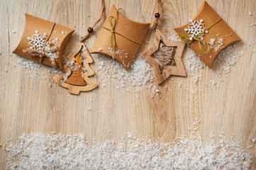 Christmas gifts in kraft paper with a homemade toys with snow