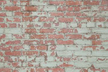 Grunge background image of worn painted brick wall