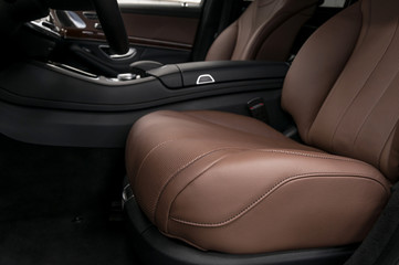 Prestige car interior background. Driver's leather seat.