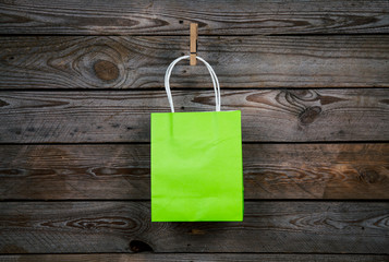 green Shopping bag on a wooden background, sale, purchase
