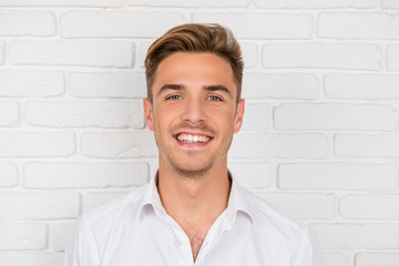 Portrait of a handsome happy man in white shirt
