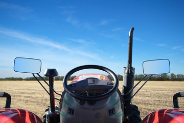 Fototapete - Riding on a tractor