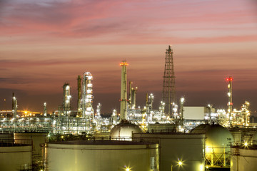 Oil and gas industry - refinery at sunset - factory - petrochemi