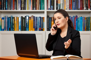 Mature woman office telephone call