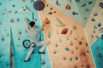 Man climbing in gym