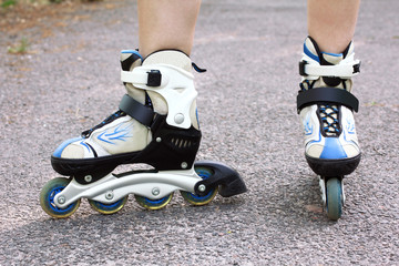 Close-up view on teenager holding roller skate