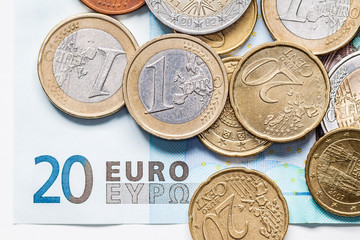 Euro Coins on a 20 Euro Banknote