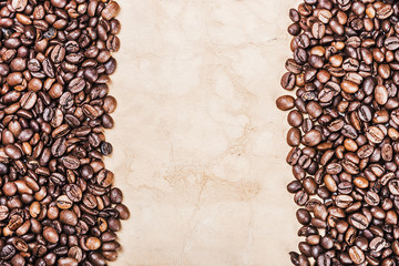 roasted coffee beans background and old paper