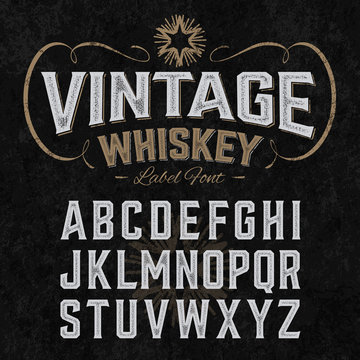 Vintage whiskey label font with sample design. Ideal for any design in vintage style.