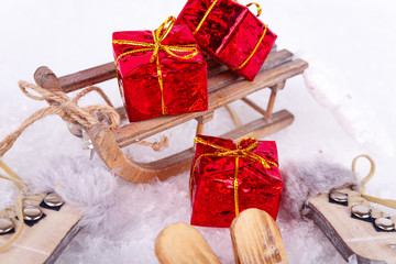 Xmas or new year composition with holiday decorations - little toy sledge with gifts boxes. Christmas card