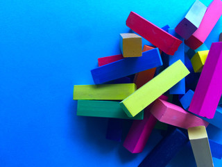 Brightly-colored pastel sticks with copy space