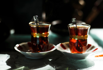 Turkish tea is served in a cafe with Bosphorus view in Istanbul, Turkey