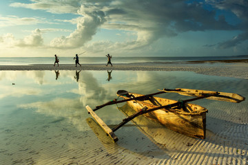 Aluminium Prints Zanzibar Traditional fisher boat in Zanzibar with people going to fish on