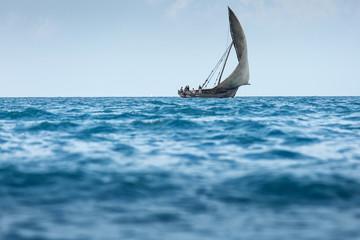Fishermen returning from work at midday on Zanzibar Island off t