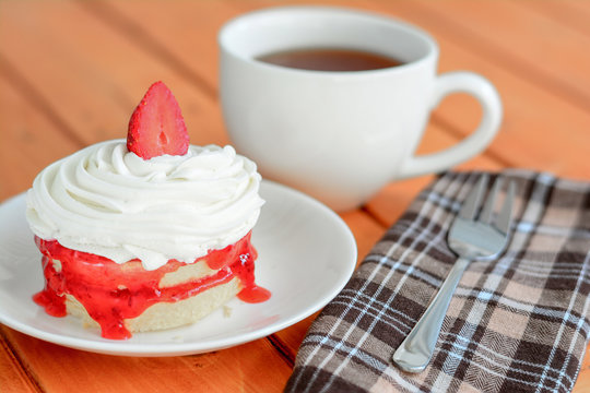 Tea break with strawberry cake.