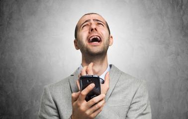 Desperate man using his mobile phone