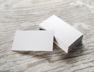 Blank business cards on wooden background. Mockup for branding identity for designers.