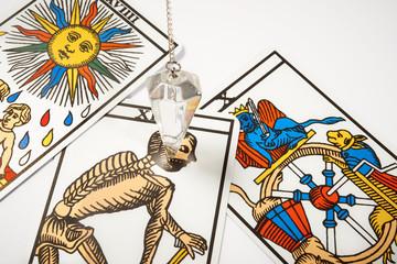 White crystal Pendulum with tarot cards