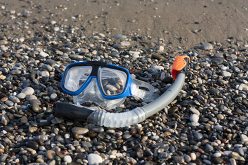 snorkel and scuba mask on the beach photo