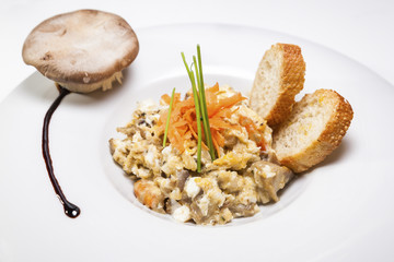 Scrambled eggs and mushrooms with carrots