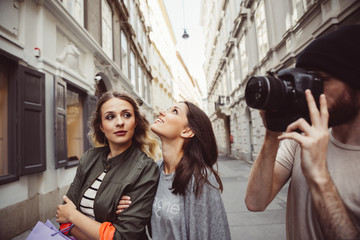 Austria, Vienna, three tourists exploring the old town