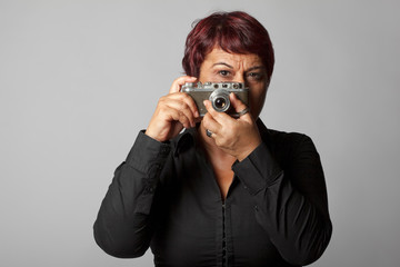 Mature photographer woman