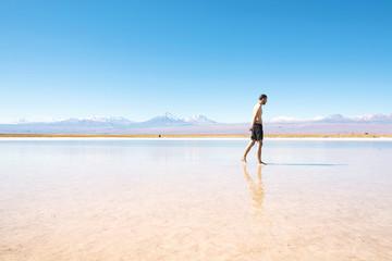 Chile, Atacama Desert, man walking at Laguna Cejar
