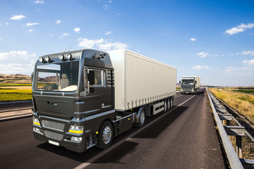 Semi-trailer trucks on highway