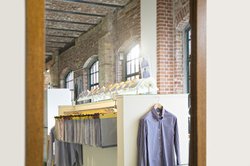 Germany, Berlin, Interior on men's tailor shop, facric samples and shirt in mirror
