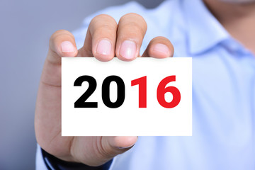 New year number 2016 on business card shown by a man