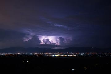 Lightning storm over city, Chiang mai, Thailand